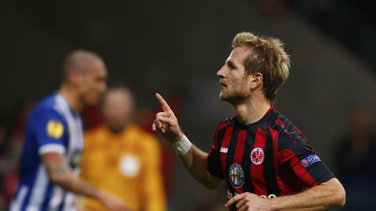 Eintracht Frankfurt's Aigner celebrates his goal against Porto during their Europa League soccer match in Frankfurt