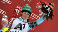 Mikaela Shiffrin, of the United States, celebrates on the podium her third place after completing an alpine ski, women's World Cup slalom, in Lienz, Austria, Thursday, Dec. 29, 2011. Mikaela Shiffrin, who started No. 40, posted the fastest time in the final run to finish 1.30 back in third for her best career result. (AP Photo/Giovanni Auletta)