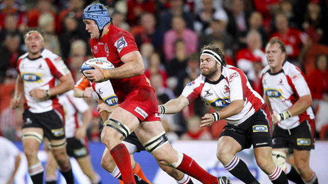 Queensland Reds captain James Horwell (C) runs past Golden Lions hooker Martin Bezuidenhout (R) during their Super 15 rugby union match at Suncorp Stadium in Brisbane on May 19, 2012.  IMAGE STRICTLY RESTRICTED TO EDITORIAL USE - STRICTLY NO COMMERCIAL USE AFP PHOTO / Patrick Hamilton  PATRICK HAMILTON/AFP/GettyImages