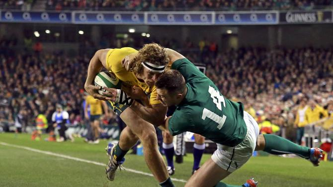 Ireland's Bowe challenges Australia's Cummins in their International rugby union match in Dublin