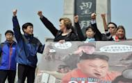 Park Sang-Hak (2nd L), who heads a group of North Korean defectors, and US human rights activist Suzanne Scholte (3rd L) protest after a planned launch of anti-North Korean leaflets near the Demilitarized Zone was blocked on May 4, 2013