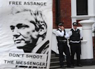 A supporter of Julian Assange holds a sign as police remain outside the Ecuadorian Embassy in London on August 18, 2012. WikiLeaks on Sunday urged Sweden, which wants to question its website's founder Julian Assange -- who is holed up in the Ecuadorian embassy in London -- over alleged sexual misconduct, to guarantee it would not extradite him to the United States