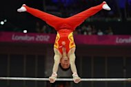 China's gymnast Zou Kai competes on the horizontal bar during the men's qualification of the artistic gymnastics event of the London Olympic Games on July 28