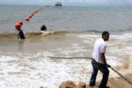 Technicians display the ACE (African Coast to Europe) submarine fiber optic cable on the shore of Libreville, Gabon, in 2011. Liberian President Ellen Johnson Sirleaf said late Monday the west African nation will get high-speed internet from October, as it connects to a fibre optic cable running along the west African coast