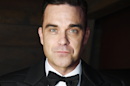 """Heavy Entertainment Show"" : Robbie Williams invite Ed Sheeran et Serge Gainsbourg sur son nouvel album"