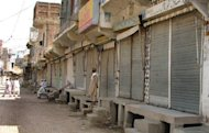 This file photo shows Pakistani shopkeepers standing outside closed market stalls in Miranshah, the main town in the troubled North Waziristan tribal district, in 2007. A US drone strike on a militant compound killed five insurgents in Miranshah early Thursday, according to officials