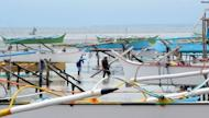 Wooden fishing boats are placed on stilts as fishermen temporarily stop work after a 7.6 magnitude earthquake and small tsunami hit the coastal town of Guiuan, eastern Philippines on September 1, 2012