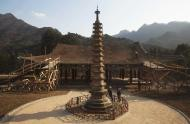 In this April 19, 2011 photo, North Korean workers rebuild the roof of a structure at the Pohyon Temple at the foot of Mount Myohyang, North Korea. (AP Photo/David Guttenfelder)