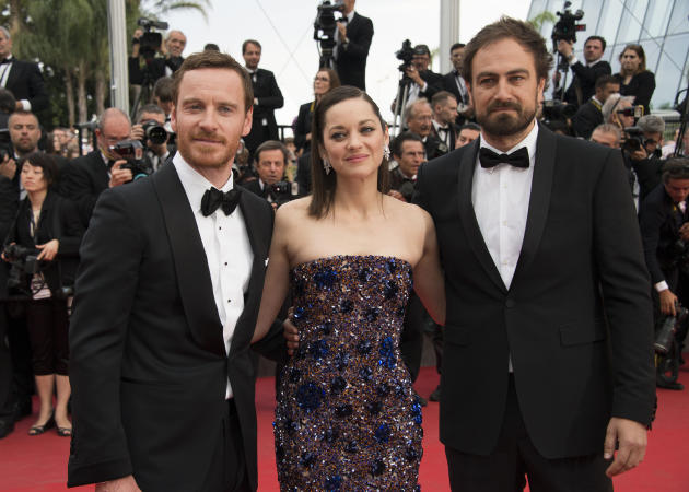 Actors Michael Fassbender and Marion Cotillard and director Justin Kurzel pose for photographers upon arrival for the screening of the film Macbeth at the 68th international film festival, Cannes, sou