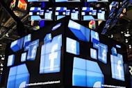 The Facebook logo is seen on a television screen display at the Samsung booth at the 2011 International Consumer Electronics Show in Las Vegas, Nevada. Estonia's justice ministry has asked parliament to adopt amendments to enable courts to use Facebook and Twitter accounts to contact crime suspects, a ministry spokesman said Monday
