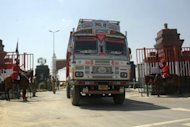 An Indian truck arrives back in India at the Wagah border crossing after transporting a shipment of goods to Pakistan. India and Pakistan, still at loggerheads on Kashmir and no closer to a full peace deal, are channelling their efforts into increasing trade in the hope that business can bring them together