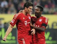 Bayern Munich's striker Mario Gomez (L) and his Austrian teammate midfielder David Alaba celebrate scoring during the German first division Bundesliga football match FC Augsburg vs FC Bayern Munich in the southern German city of Augsburg. Ten-man Bayern Munich went five points clear again at the top of the German league on Sunday as Gomez scored his 20th goal of the season in a 2-1 win