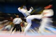 Photo illustration. A taekwondo fighter who helped fund his Olympic dream by running a brothel has rejected being labelled a 'pimp', pointing out that prostitution is legal in his native New Zealand