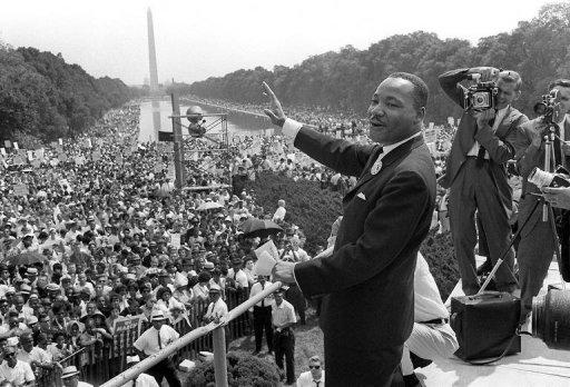 US civil rights leader Martin Luther King, Jr., waves from the steps of the Lincoln Memorial on 28 August, 1963