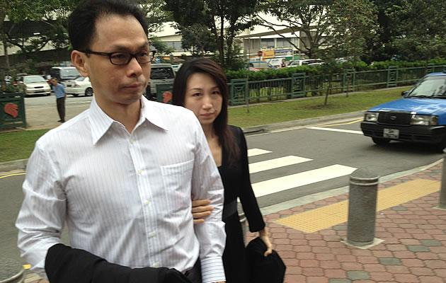 Ex-CNB chief, Ng Boon Gay, and his wife arrive at the Subordinate Courts for the sixth day of the sex-for-contracts hearing in October 2012. (Yahoo! photo)