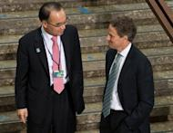 US Treasury Secretary Timothy Geithner (R) chats with South Korean Finance Minister Bahk Jae-wan as they prepare to pose for the G20 finance ministers and central bank governors family photo at the IMF/World Bank Annual Spring Meetings in Washington, April 20. The IMF raised $430 billion in new funds for crisis intervention Friday, with China and other emerging economic giants taking part