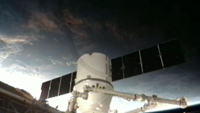 This frame grab made available by NASA TV shows a view of the SpaceX Dragon anchoring to the International Space Station Sunday, March 3, 2013. SpaceX, the California-based company founded by billionaire Elon Musk, had to struggle with the Dragon following its launch Friday from Cape Canaveral. The spacecraft is delivering more than 1 ton of supplies to the the International Space Station. (AP Photo/NASA TV)
