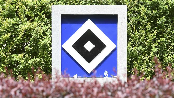 A grave stone is pictured at a cemetery specially designated for fans of German Bundesliga soccer club Hamburg SV near the stadium in Hamburg