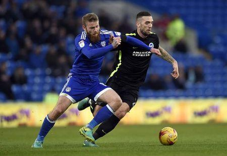 Cardiff City's Aron Gunnarsson in action with with Brighton and Hove Albion's Shane Duffy
