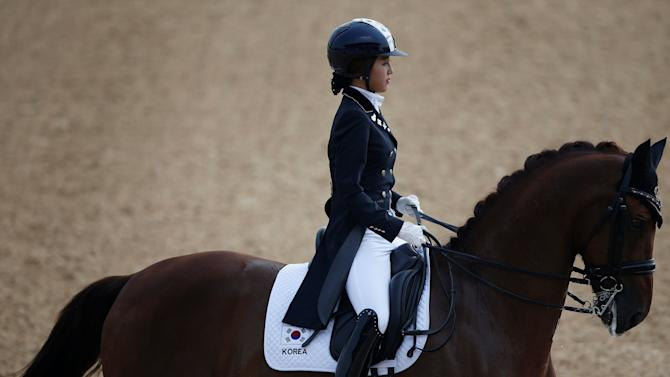 South Korea's Chung Yoo-ra, then known as Chung Yoo-yeon, performs during the equestrian Dressage Team competition at the Dream Park Equestrian Venue during the 17th Asian Games in Incheon