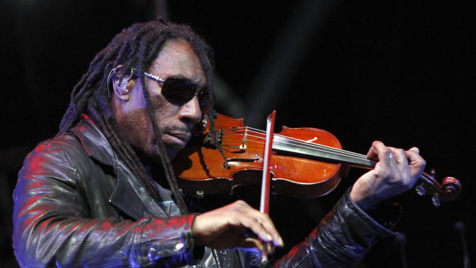 FILE - This April 5, 2013 file photo shows Boyd Tinsley of the Dave Matthews Band performing at the NCAA Final Four Big Dance Concert in Centennial Olympic Park in Atlanta, Ga. Court documents say Getty Andrew Rothenberg pleaded guilty Tuesday, July 23, embezzling at least $400,000 from Tinsley. The documents say the 39-year-old Richmond man embezzled the money while working as Tinsley's personal assistant and financial manager. (Photo by Dan Harr/Invision/AP, File)