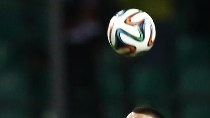 Russia's Vasiliy Berezutskiy, right, competes for a ball with Armenia's Sarkis Adamyan during international friendly soccer match in Krasnodar, Russia, Wednesday, March 5, 2014. Russia won 2-0