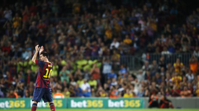 Barcelona's Messi acknowledges the crowd during his substitution in their Spanish First division soccer league match against Real Sociedad in Barcelona