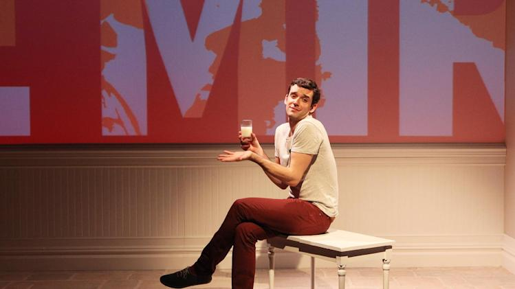"This theater image released by Richard Kornberg & Associates shows Michael Urie during a performance of ""Buyer & Cellar,"" in New York. The Juilliard-trained Urie plays a struggling actor who lands a job as a clerk in an underground mall of quaint shops. (AP Photo/Richard Kornberg & Associates, Sandra Coudert)"