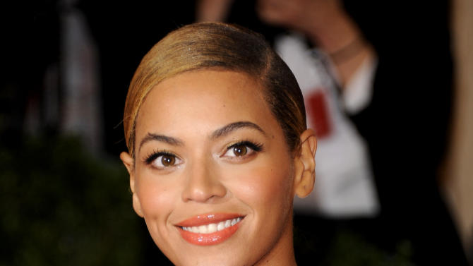 FILE - This May 7, 2012 file photo shows Beyonce Knowles at the Metropolitan Museum of Art Costume Institute gala benefit, celebrating Elsa Schiaparelli and Miuccia Prada in New York. President Obama released an official playlist through the digital music service Spotify on Thursday, Jan. 18, 2013. The list includes songs by Beyonce, Stevie Wonder, John Legend, Usher, fun. and other acts set to perform during various inauguration events. (AP Photo/Evan Agostini, File)