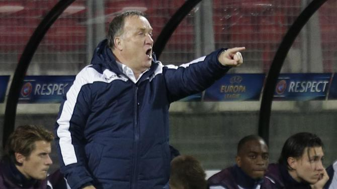 AZ's coach Dick Advocaat gives directions to his players during the Europa League Group L soccer match between AZ Alkmaar and Kazakhstan's FC Shakhter Karagandy at AFAS stadium in Alkmaar, Netherlands, Thursday, Nov. 7, 2013. AZ won the match with a 1-0 score