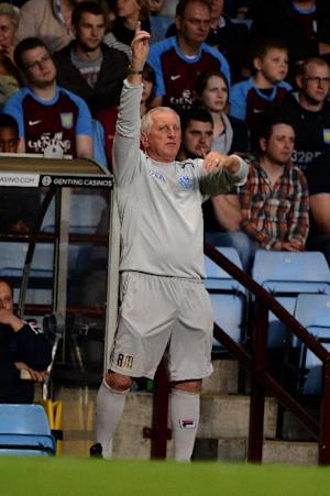 Ronnie Moore has urged Tranmere to not get caught up in Bournemouth's welcome party