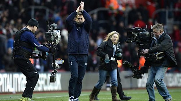Tottenham Hotspur caretaker manager Tim Sherwood gestures to fans after winning their English Premier League soccer match against Southampton at St Mary's stadium in Southampton, southern England December 22, 2013. REUTERS