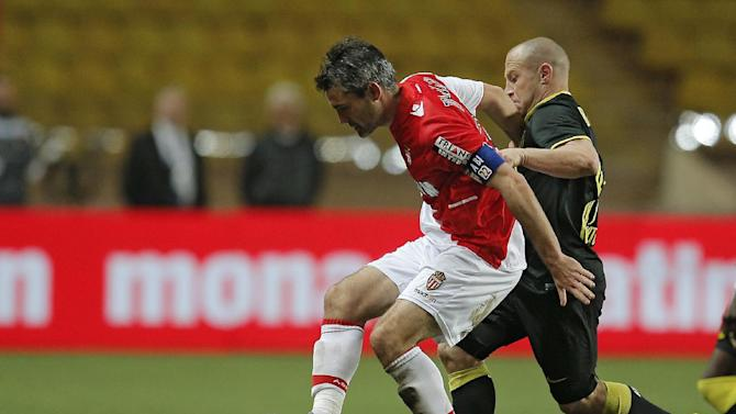 Monaco's Jeremy Toulalan of France, left , challenges for the ball with Lille's Florent Balmont of France during their French League One soccer match, in Monaco stadium, Sunday, March 23, 2014