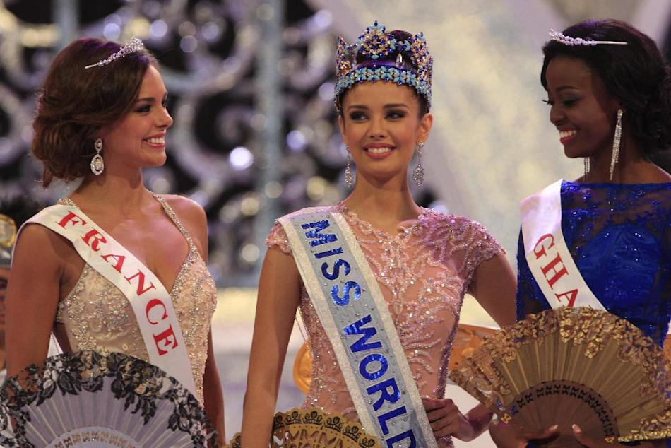 Newly crowned Miss World, Megan Young of Philippines, center, with second runner-up Miss France Marine Lorpheline, left, and third runner-up Miss Ghana Carranza Naa Okailey Shooter, smile after they w