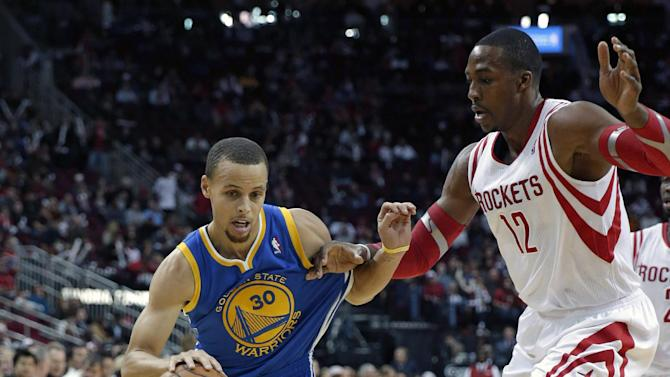 Golden State Warriors' Stephen Curry (30) drives around Houston Rockets' Dwight Howard (12) during the first quarter of an NBA basketball game Friday, Dec. 6, 2013, in Houston