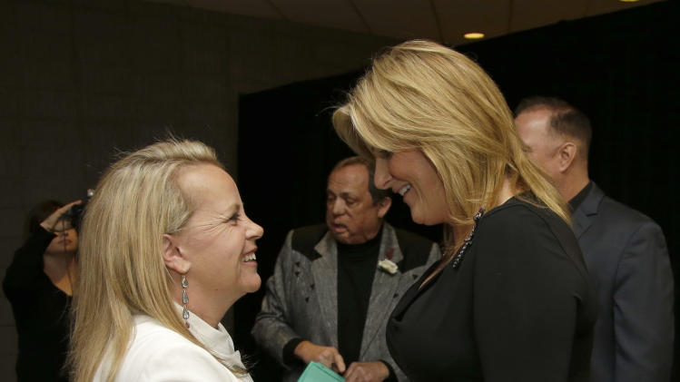 Mary Chapin Carpenter, left, greets Trisha Yearwood before the Nashville Songwriters Hall of Fame inductions on Sunday, Oct. 7, 2012, in Nashville, Tenn. Carpenter is one of the inductees. (AP Photo/Mark Humphrey)