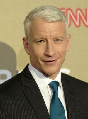 "FILE - In this Sunday, Dec. 2, 2012 file photo, reporter Anderson Cooper arrives at CNN Heroes at The Shrine Auditorium in Los Angeles. Cooper won't be in Buffalo, N.Y., to celebrate the city's heritage on Dyngus Day, a holiday that made his show's ""Ridiculist"" and left him giggling uncontrollably on the air last year.  (Photo by Dan Steinberg/Invision/AP, File)"