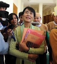 Myanmar opposition leader Aung San Suu Kyi talks to the media during a break from the lower house of parliament in Naypyidaw. Suu Kyi's parliamentary debut marked a new phase in her near quarter century struggle to bring democracy to her army-dominated homeland