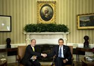 US President Barack Obama (R) and President of the Philippines Benigno Aquino shake hands after a meeting in Washington, DC. The United States and the Philippines called for freedom of navigation in the tense South China Sea as the White House offered a robust show of support for President Benigno Aquino