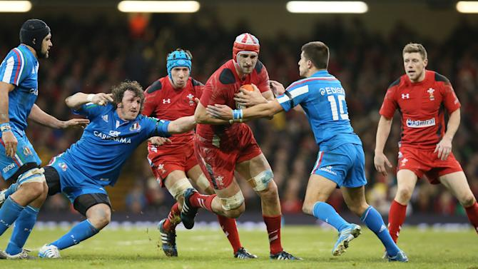 Wales's Luke Charteris, centre left, is tackled by Italy's Tommaso Allan, second right, during their Six Nations international rugby union match between Wales and Italy at the Millennium stadium in Cardiff, Wales, Saturday, Feb. 1, 2014. (AP Photo/Alastair Grant)