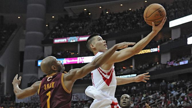 Houston Rockets' Jeremy Lin, right, goes to the basket as Cleveland Cavaliers' Jarrett Jack (1) tries to stop him in the second half of an NBA basketball game Saturday, Feb. 1, 2014, in Houston. Lin scored the first triple-double of his career in the  Rockets 106-92 win