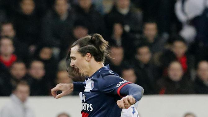 Paris Saint Germain's Zlatan Ibrahimovic of Sweden, front, vies for the ball with Lyon's Bakary Kone during their French League One soccer match, Sunday Dec. 1, 2013, in Parc des Princes stadium, in Paris, France