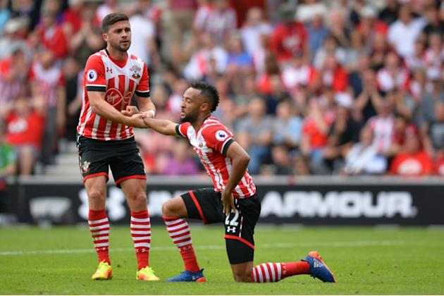 Southampton will be without Shane Long (L) when they travel to Manchester City because of a hamstring injury