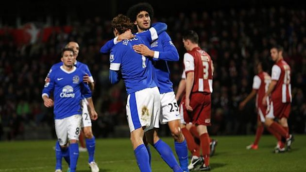 Jelavic of Everton celebrates with Fellaini after scoring his team's first goal against Cheltenham Town during their FA Cup third round match at the Abbey Business Stadium in Cheltenham