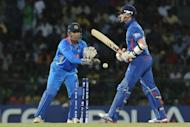 "England's Graeme Swann (R) is dismissed by India's Mahendra Singh Dhoni during their World Twenty20 match on September 23. ""But they are a very good side that has done really well in the last year. So you will see them adapt to conditions and get better in the future,"" Dhoni said"