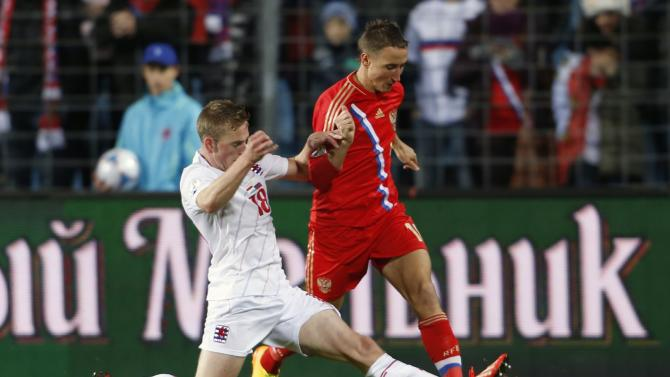 Luxembourg's Jans tackles Russia's Bystrov during their 2014 World Cup qualifying soccer match in Luxembourg