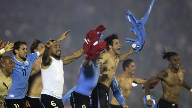 Uruguay's players celebrate at the end of their 2014 World Cup qualifying playoff second leg soccer match against Jordan in Montevideo