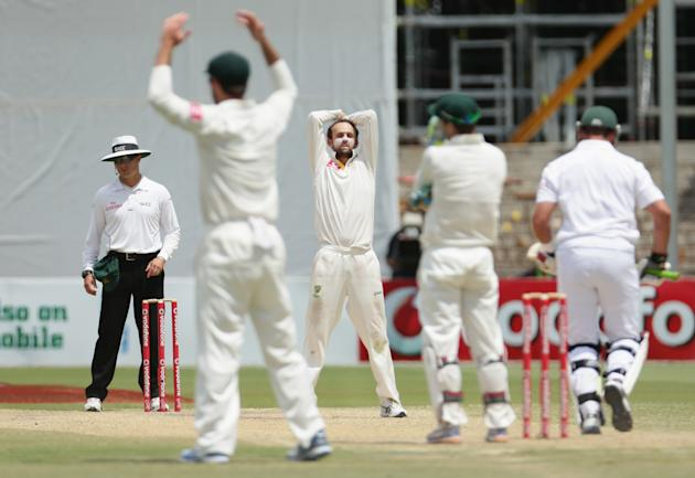 ADELAIDE, AUSTRALIA - NOVEMBER 26:  Nathan Lyon of Australia looks on after bowling a delivery during day five of the Second Test Match between Australia and South Africa at Adelaide Oval on November