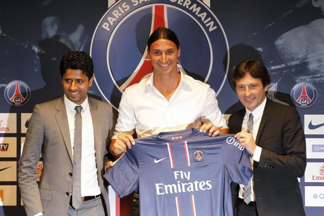 Ibrahimovic, newly-signed player for French soccer club Paris St Germain, holds his new jersey beside PSG President Al-Khelaifi and PSG sports director Leonardo after a news conference in Paris
