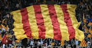 "A giant Catalan flag is displayed by supporters of Artur Mas, leader of Spain's Catalonia region, during a final meeting for his re-election campaign. Mas vowed Friday to fight for the ""future of our nation"" before a roaring crowd of supporters, ahead of weekend elections that could lead to a popular demand for statehood."